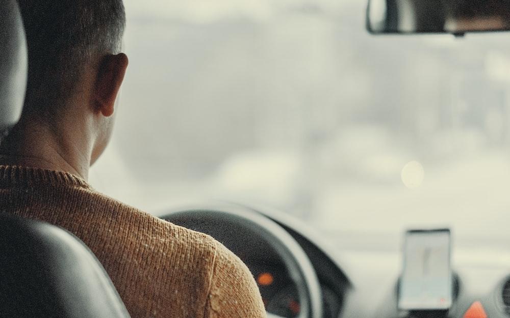 man driving vehicle