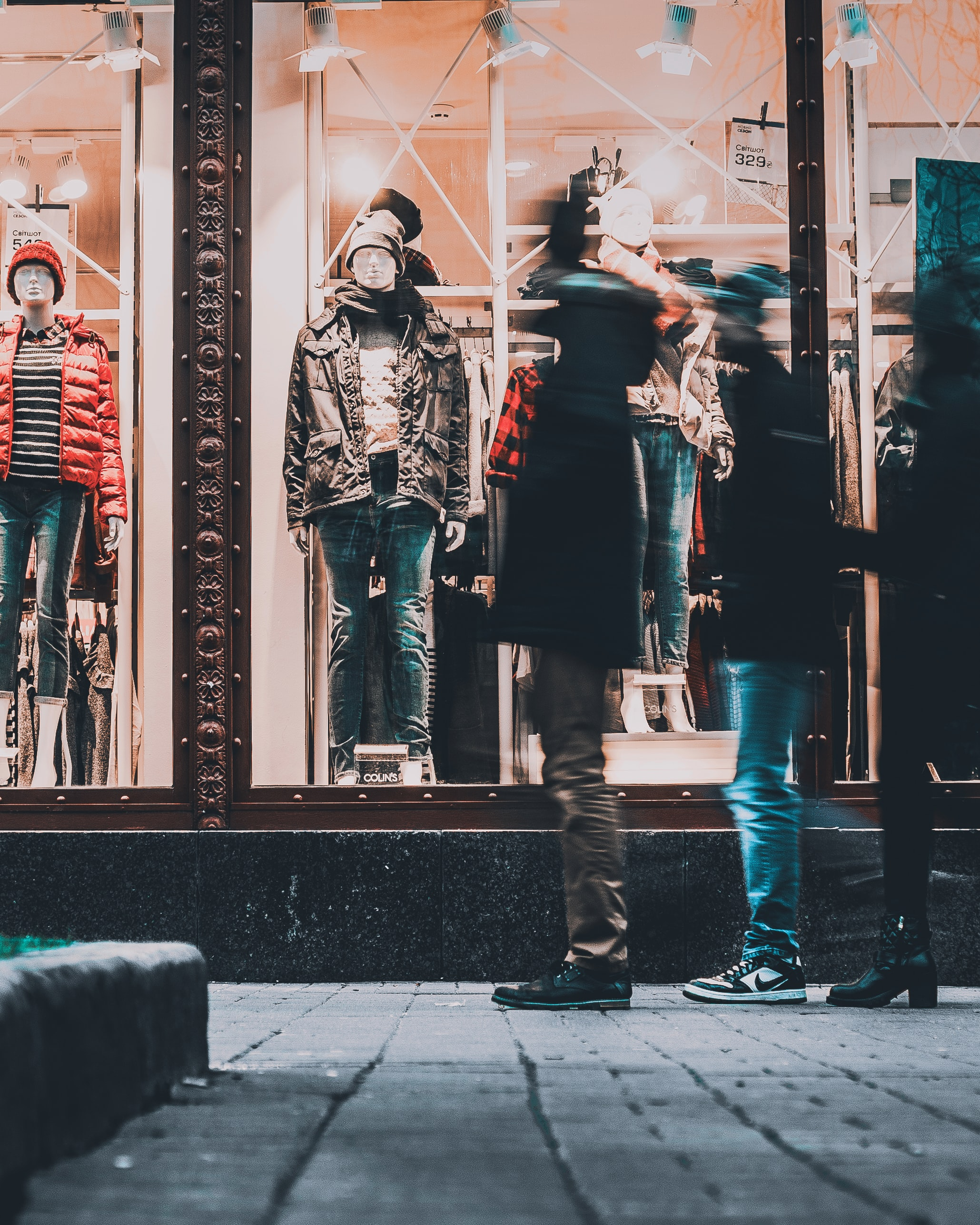 people watching manequins wearing jackets