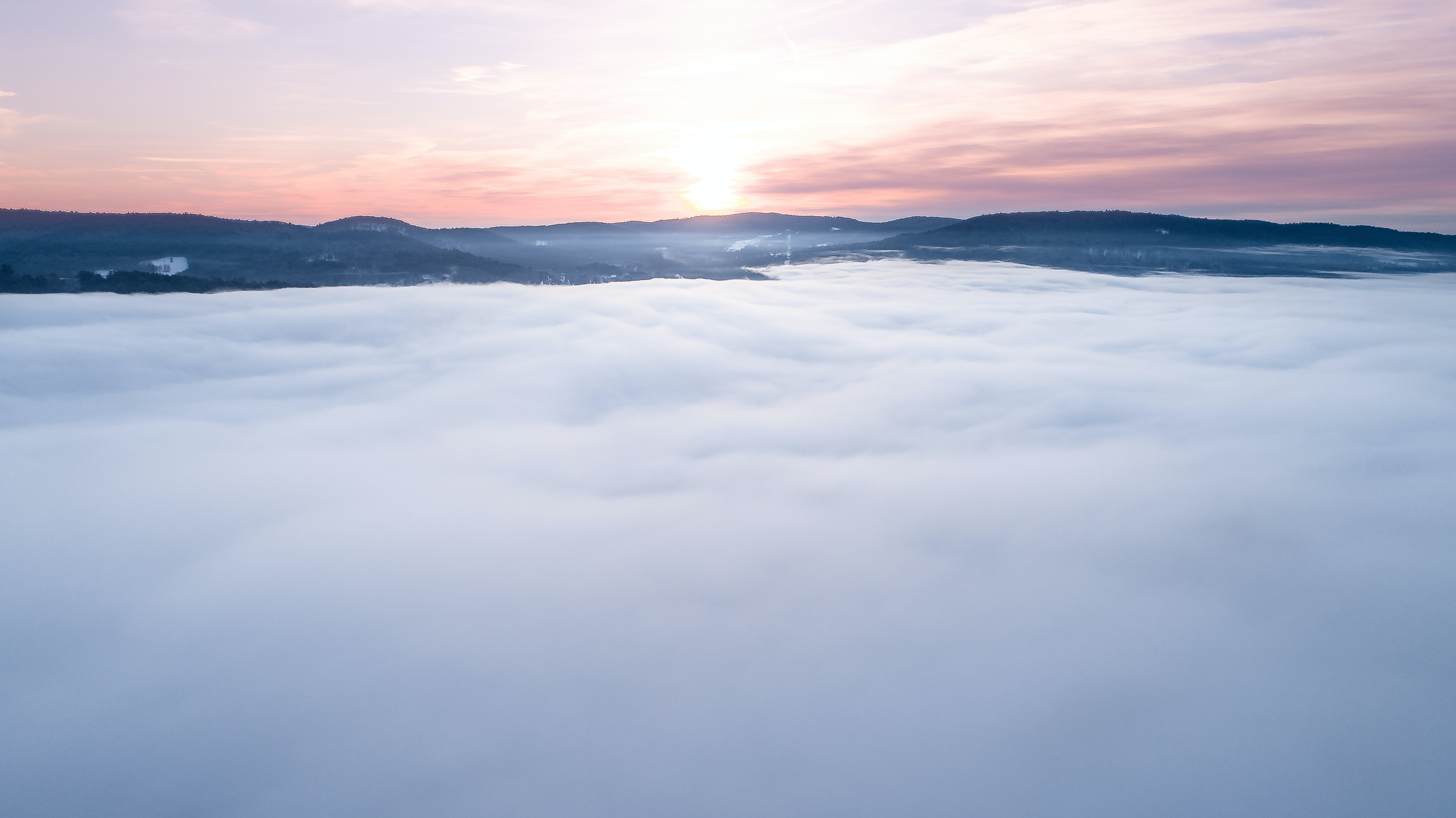landscape photography of white clouds over mountain