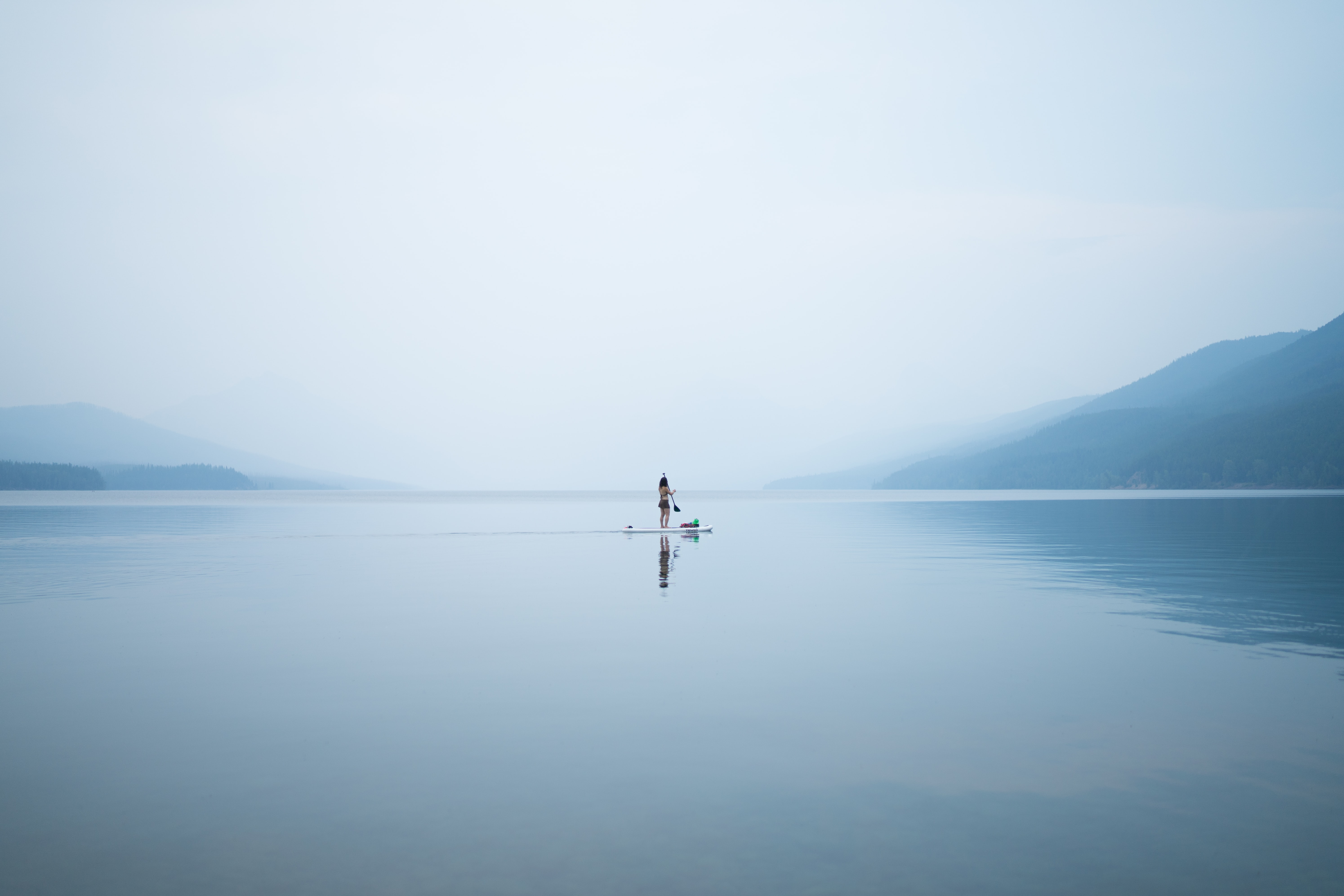 photo of person on calm body of water
