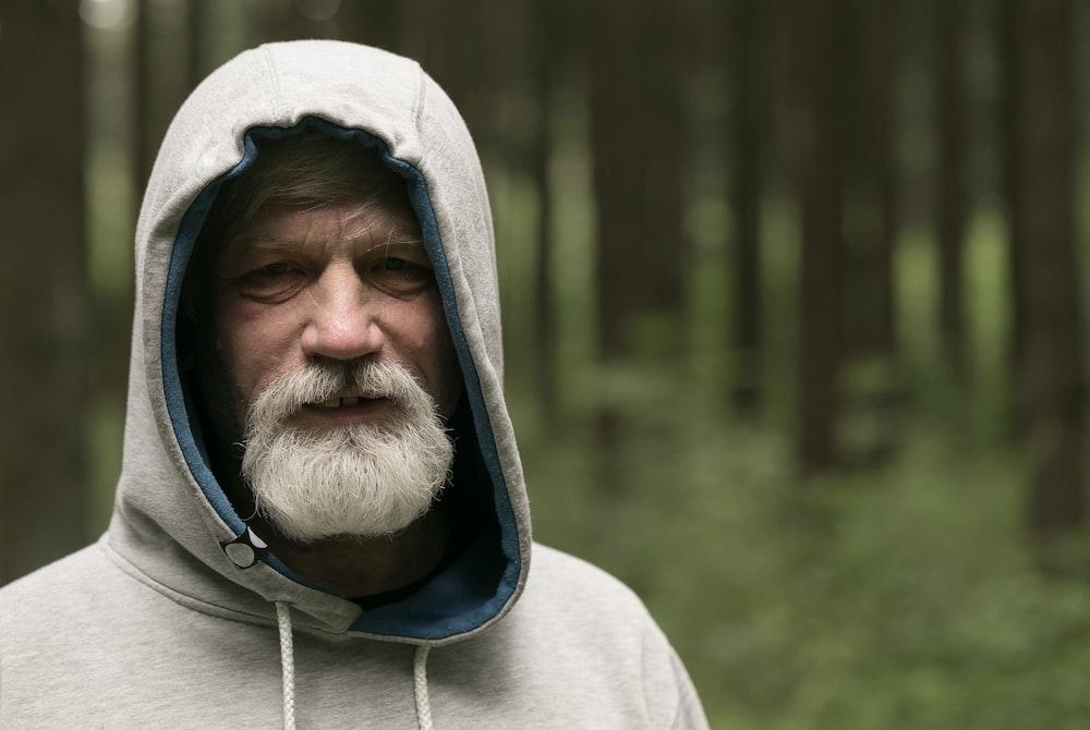 man wearing gray and black hoodie