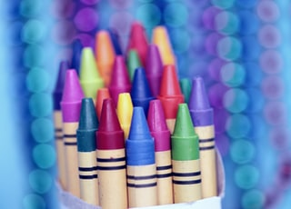 The lovely bokeh in the background was made by hanging strings of colorful beads behind the box of crayons.