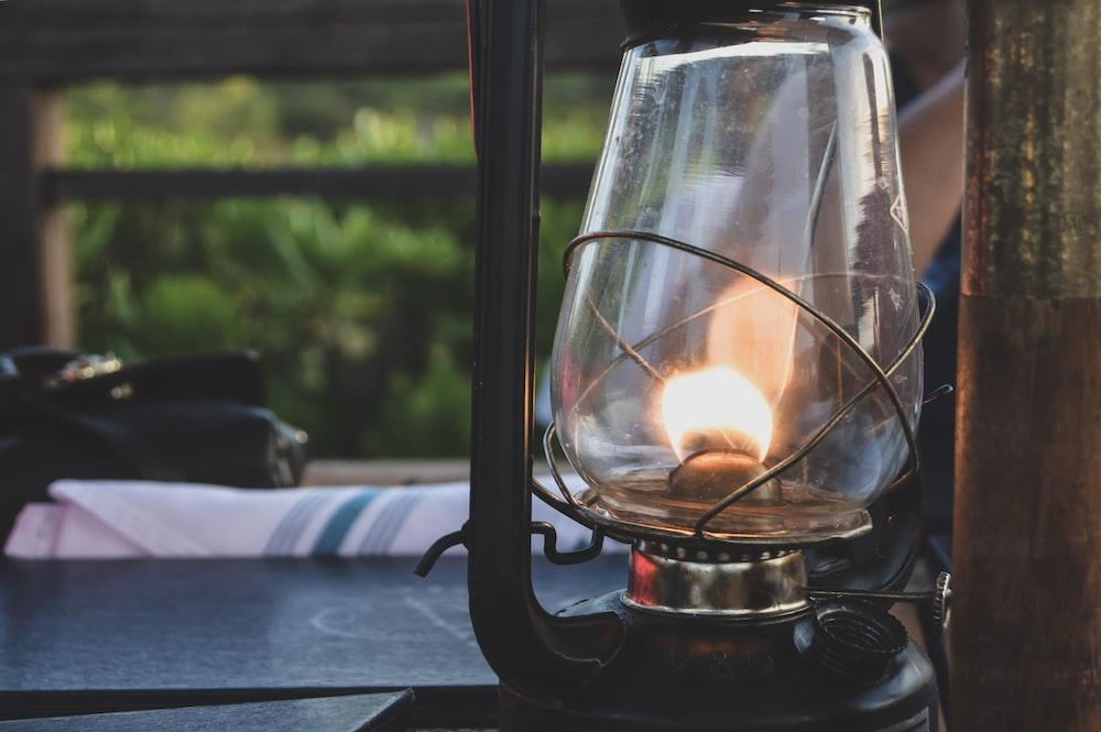 closeup photo of lighted tubular lantern