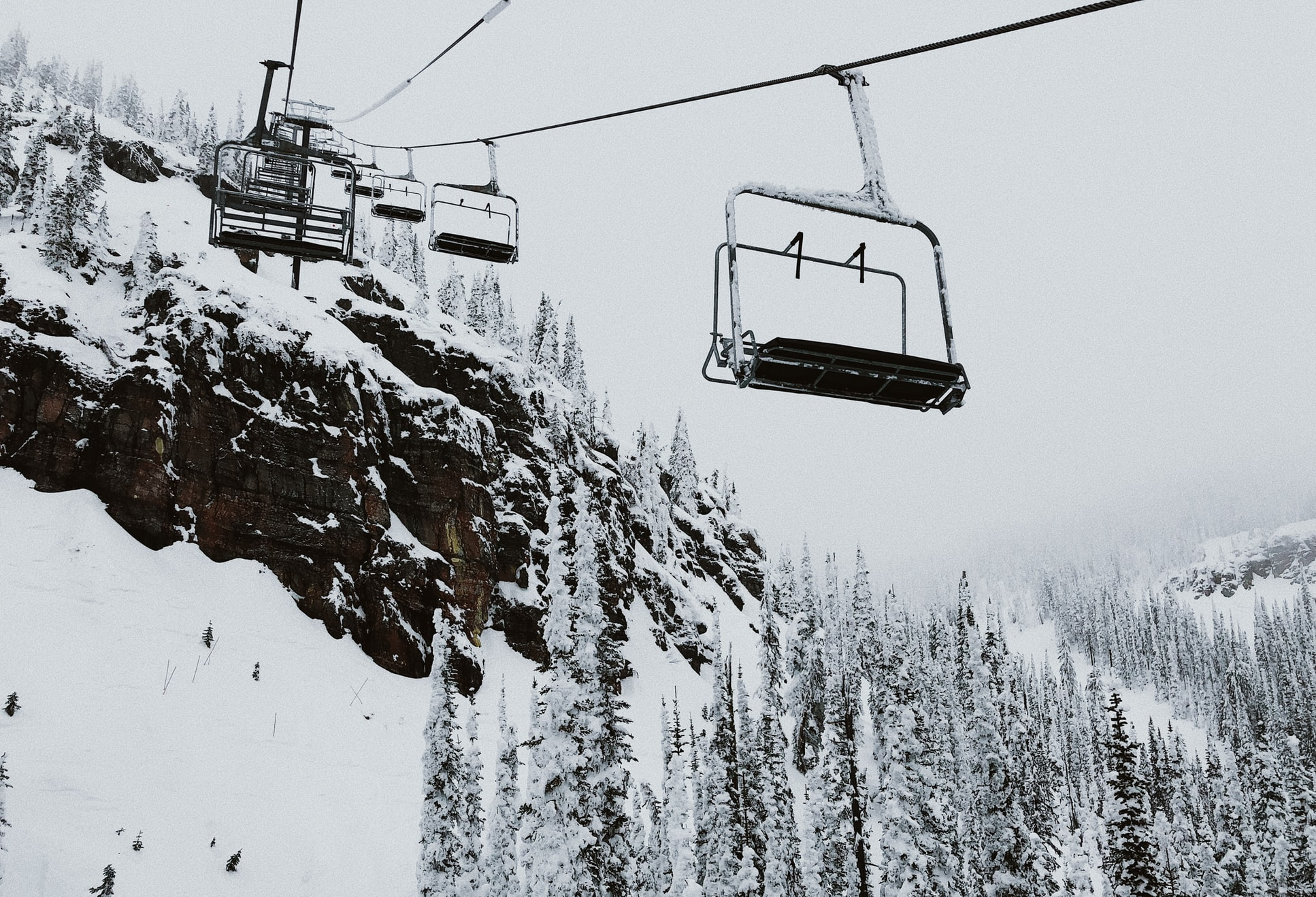 ski lifts over snowy slopes in whitefish, montana