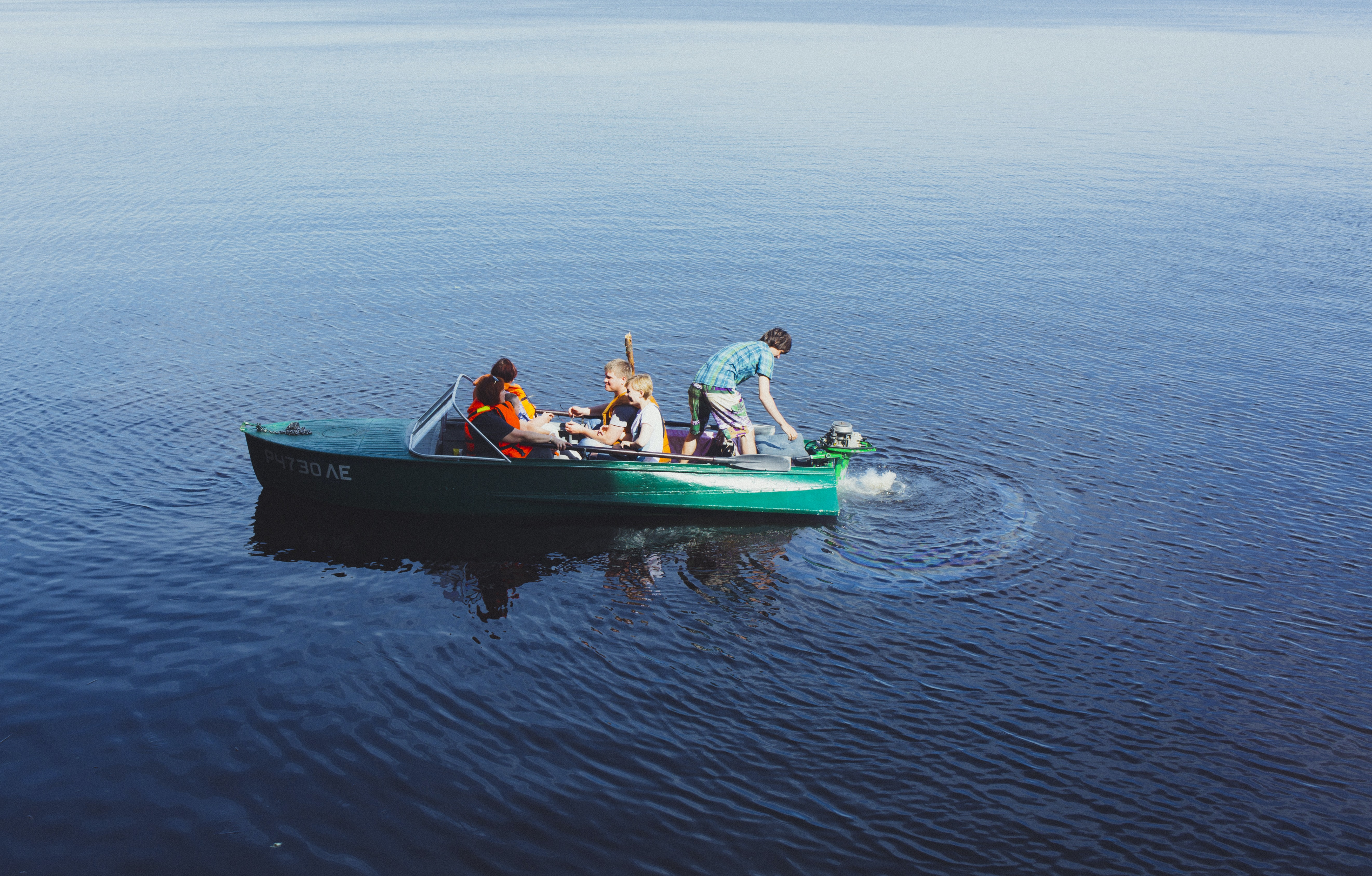 people riding power boat