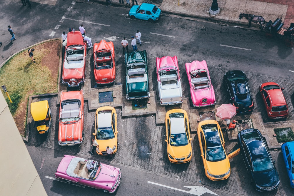 assorted cars parked during daytime