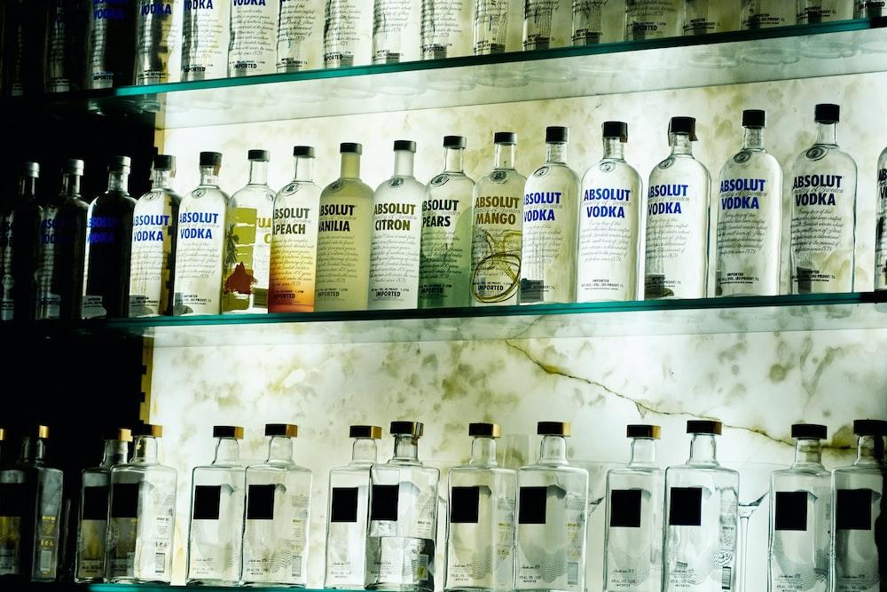 Absolute Vodka bottle lot on glass racks