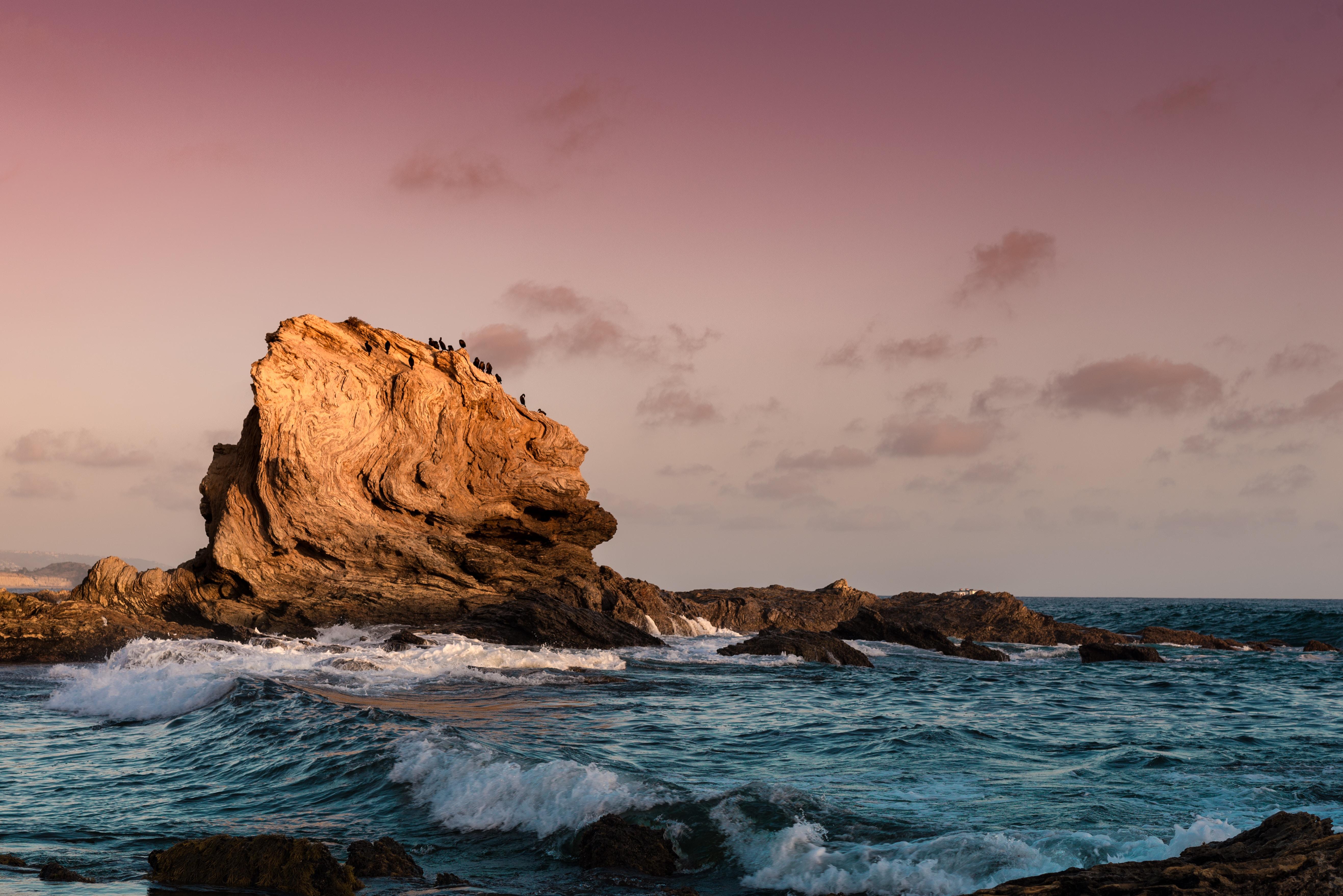 sea waves and boulder