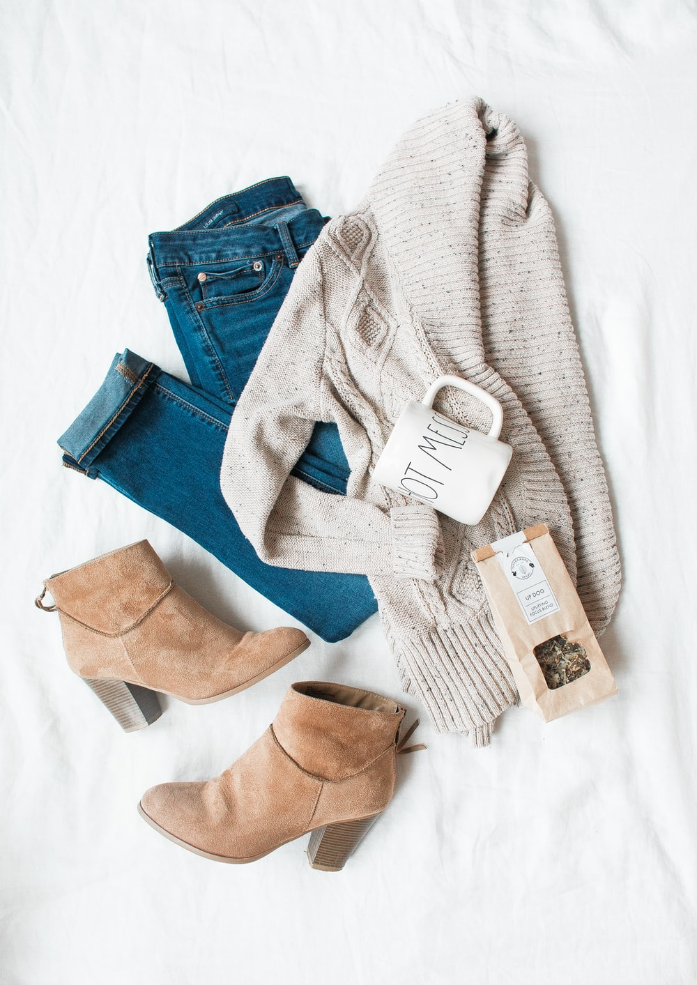 gray cardigan, blue jeans, and pair of brown chunky heeled shoes