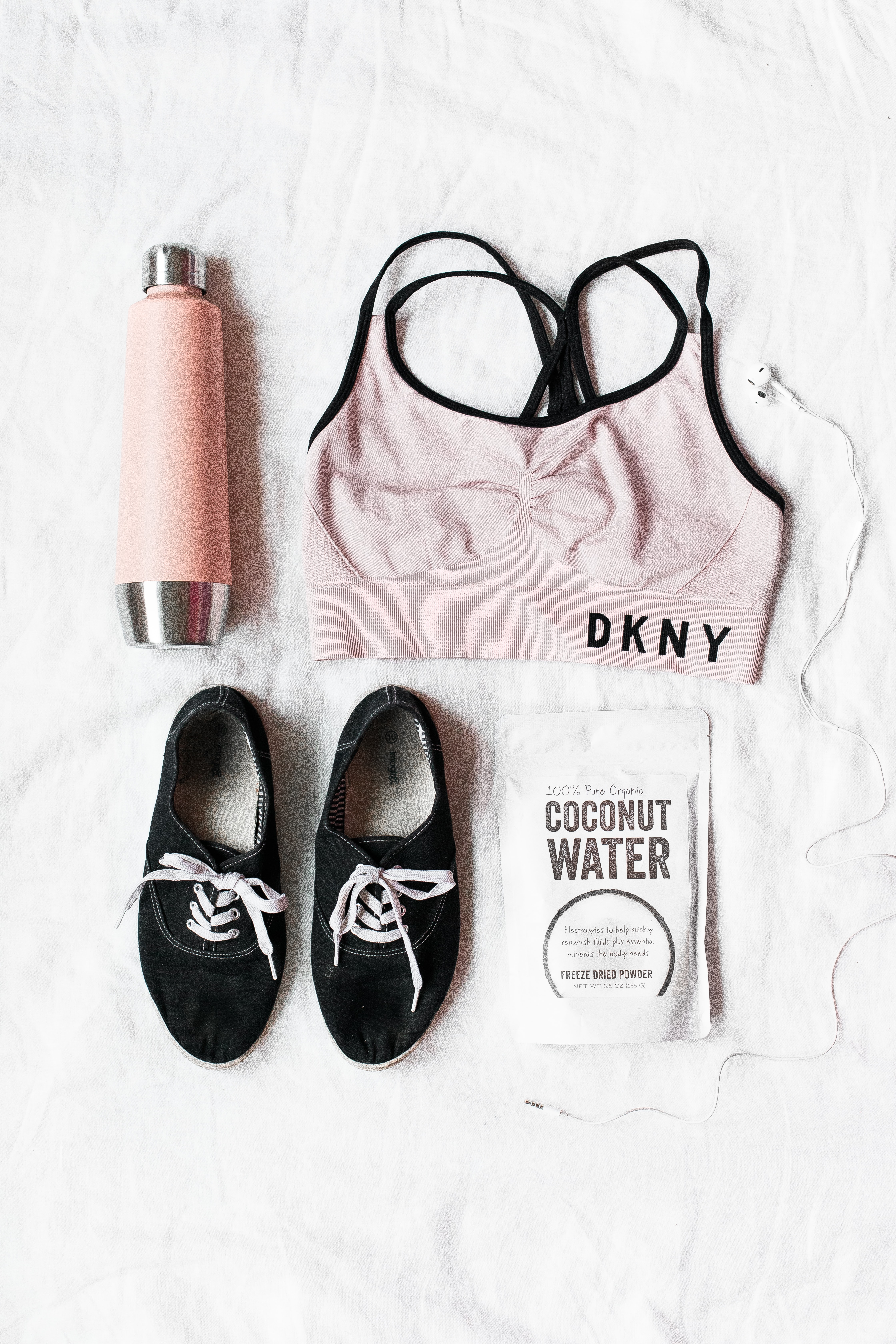 pair of black lace-up shoes near DKNY sport bra