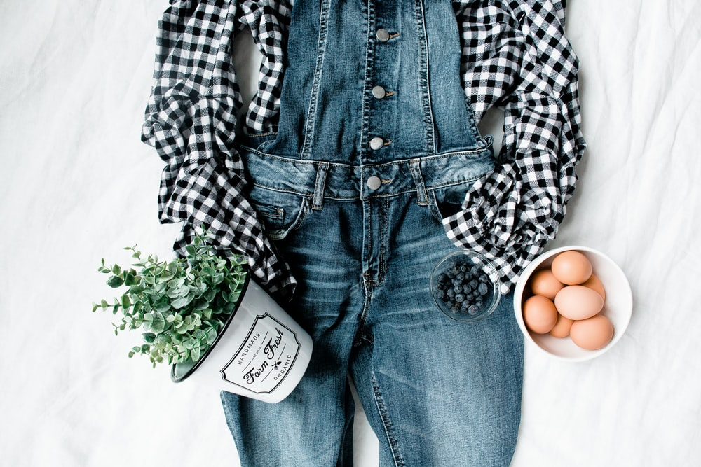 flat lay photography of clothes, eggs, and flowers