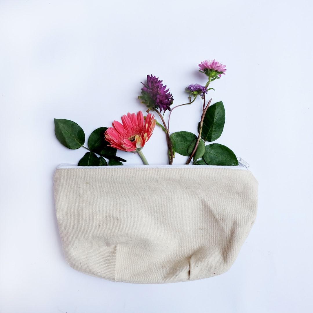 canvas pouch with floral arrangement