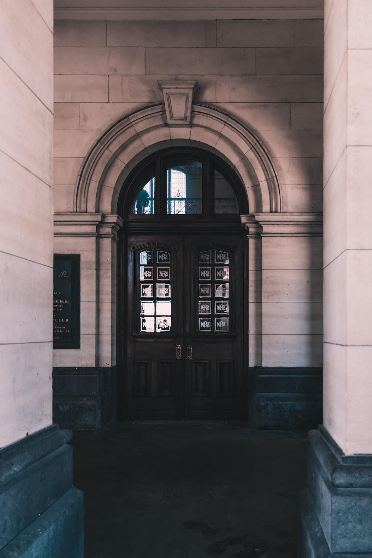 brown wooden door of the building
