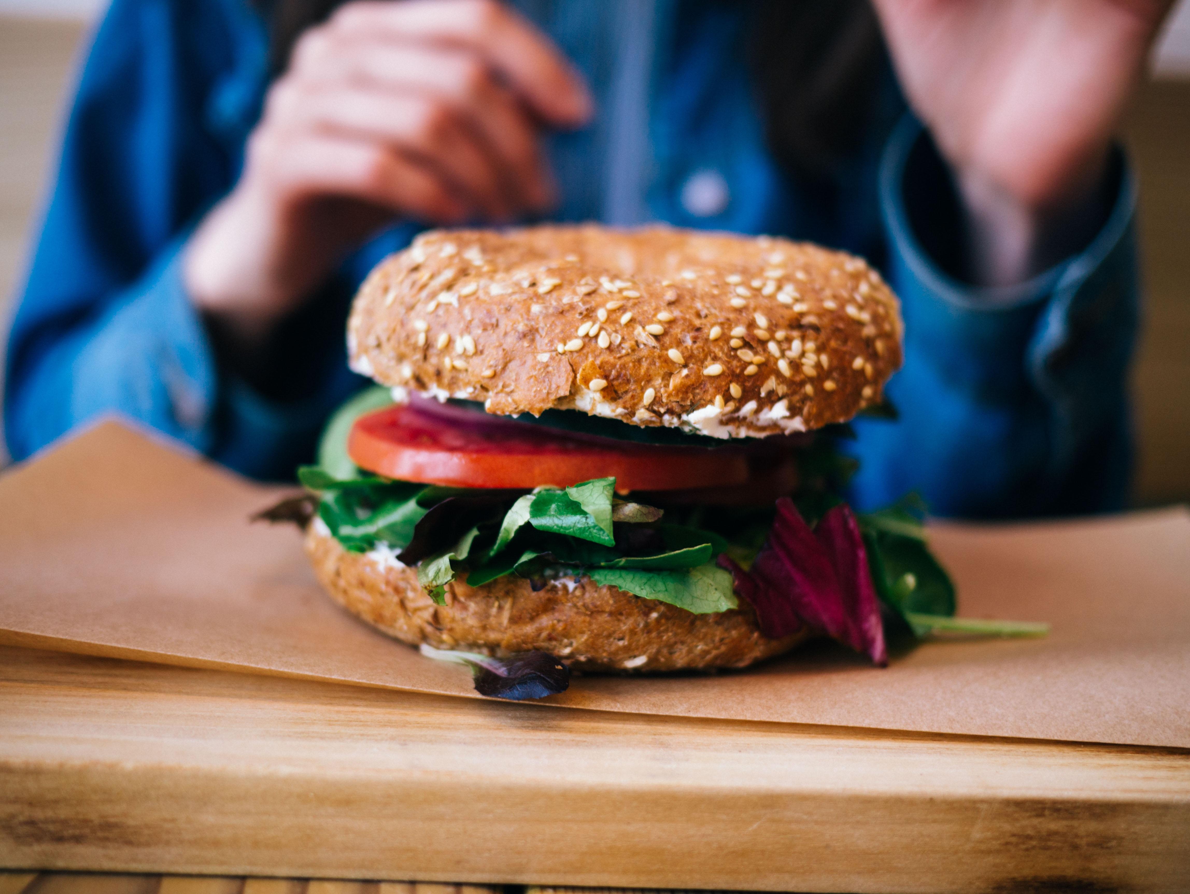 tilt photography of burger on brown pad