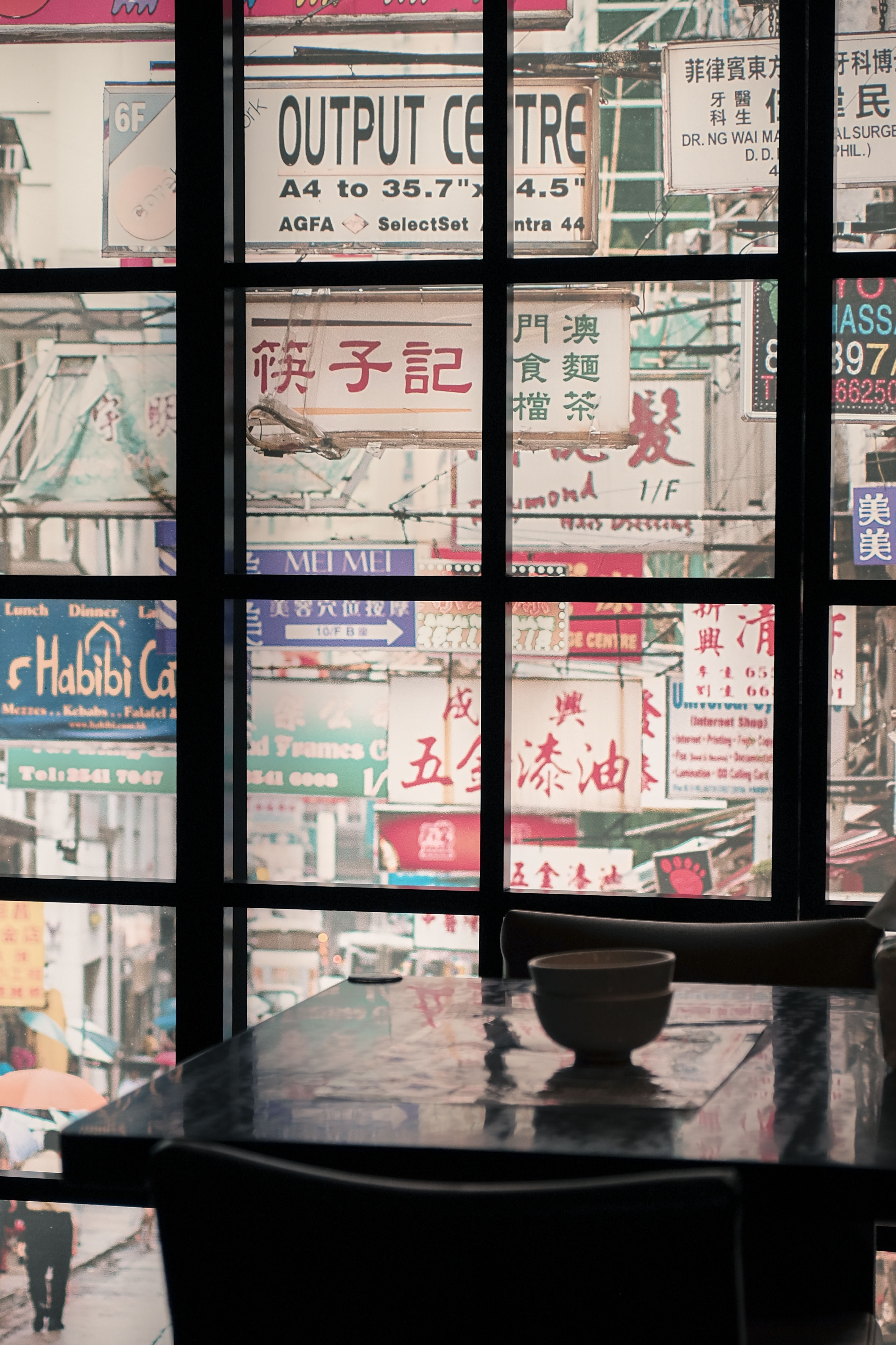 view of assorted signages through window