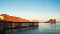 photo of brown dock near mountain