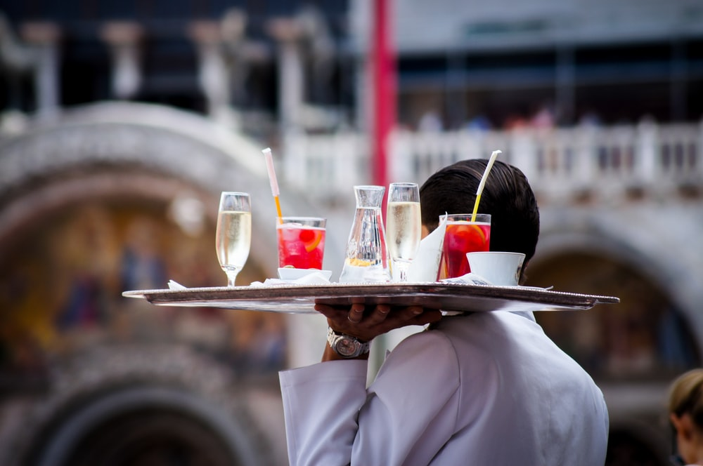 waiter serving beverages