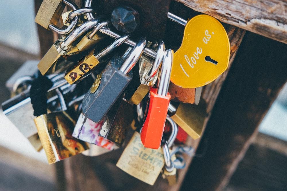 assorted-color padlocks locked on hook