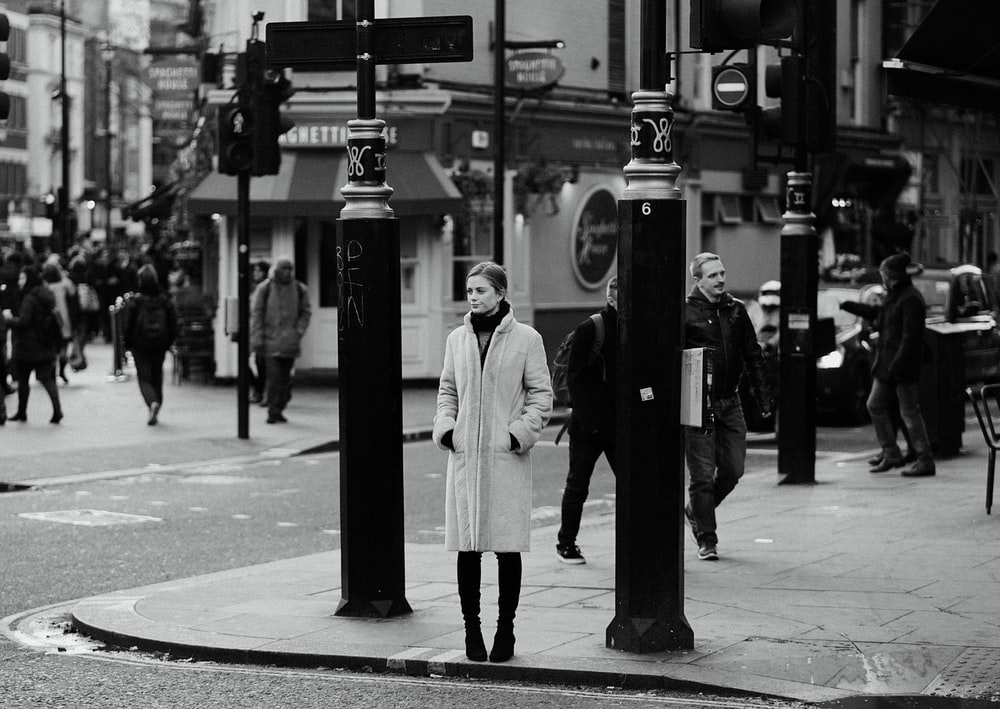 grayscale photography of people walking on street during daytime