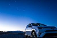 white Toyota 5-door hatchback
