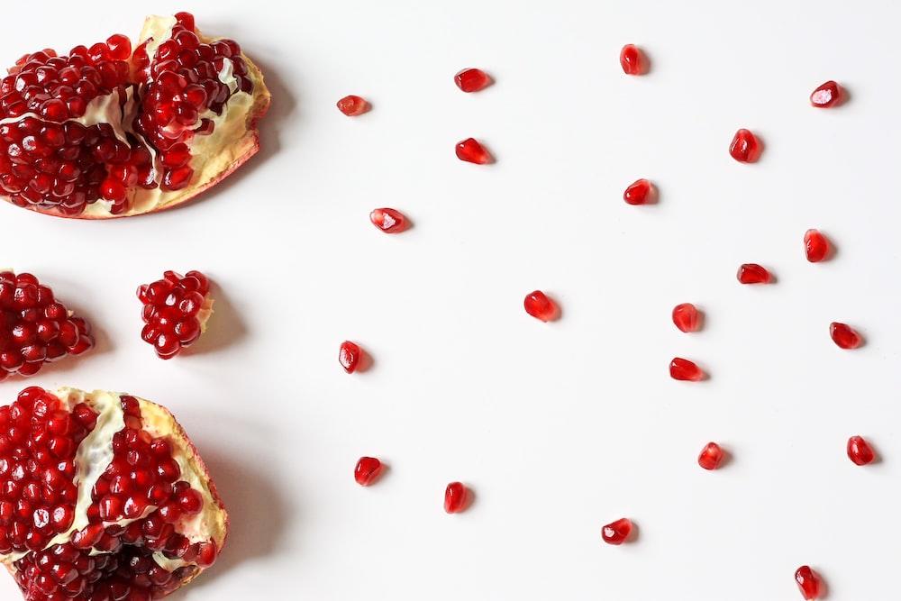 closeup photo of sliced pomegranate fruit