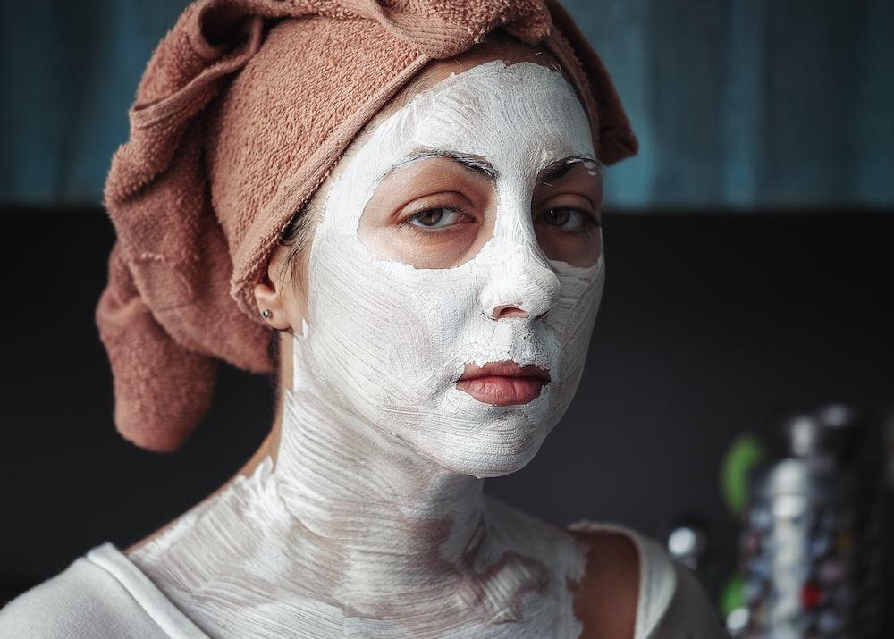 shallow focus photography of woman having a facial