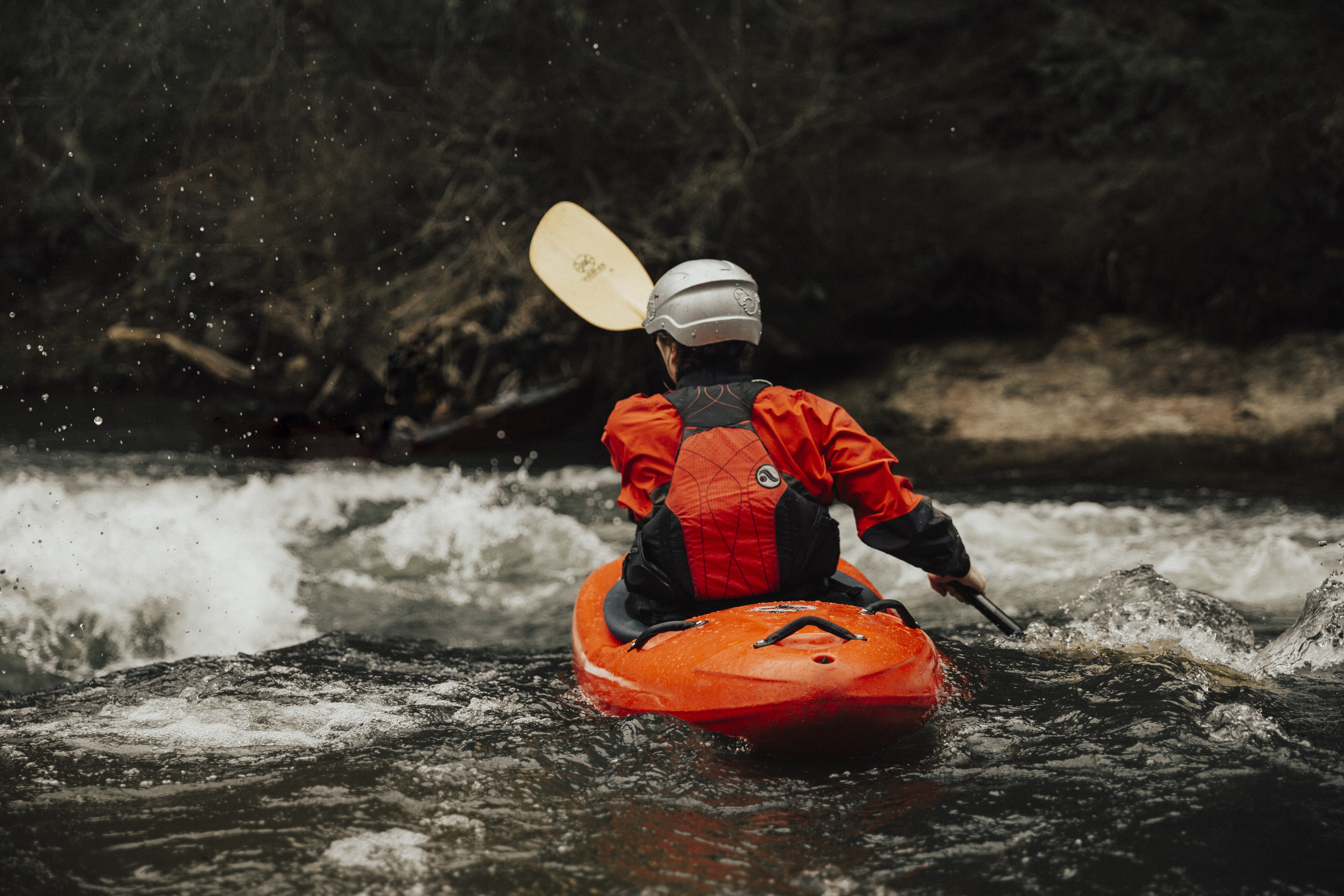 person water rafting on body of water