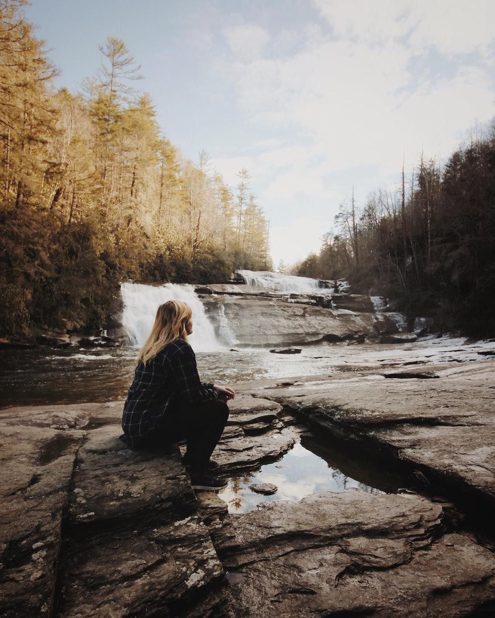 woman sitting near falls