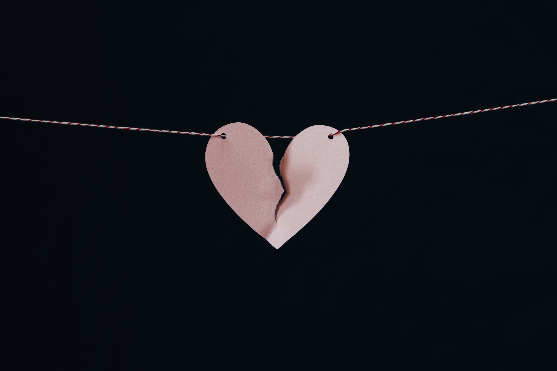 broken heart hanging on wire