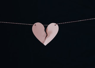 broken heart hanging on wire