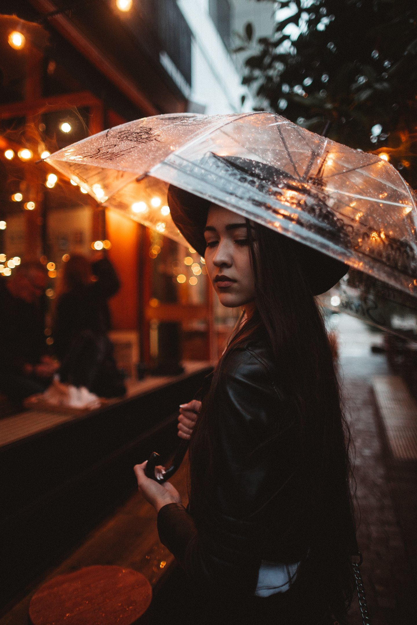 woman wearing black jacket using umbrella