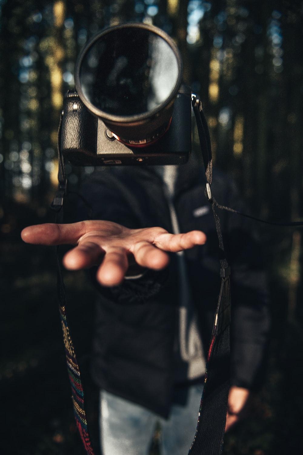 hanging black DSLR camera photography