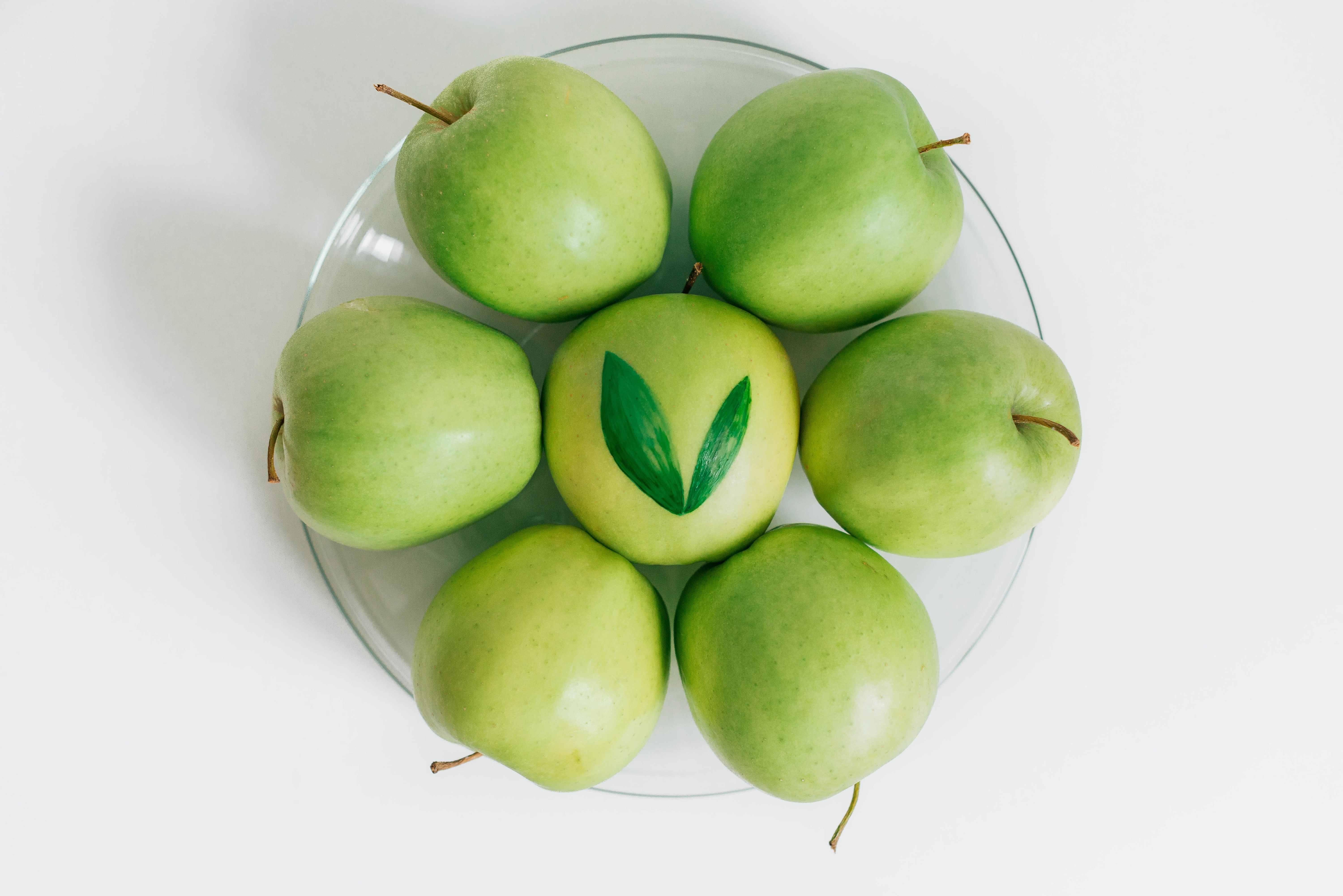 seven green apples served on bowl