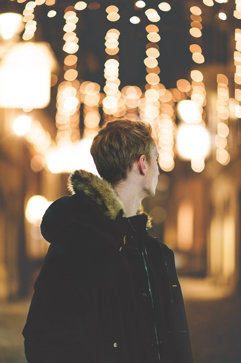 bokeh photograph of man in black parka jacket