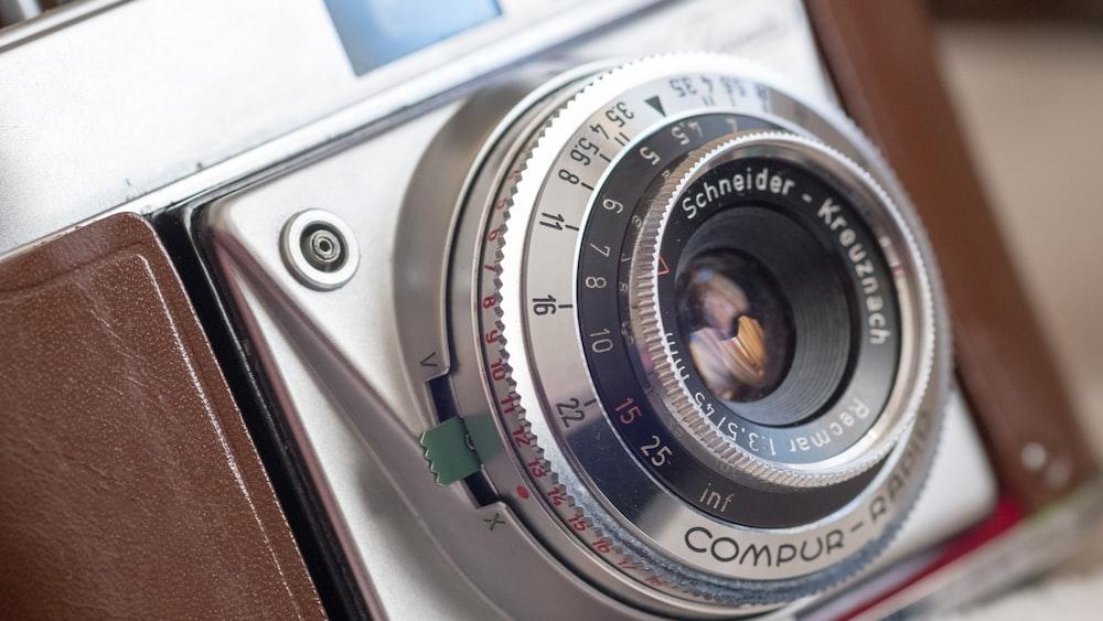 macro shot photograph of silver and black SLR camera