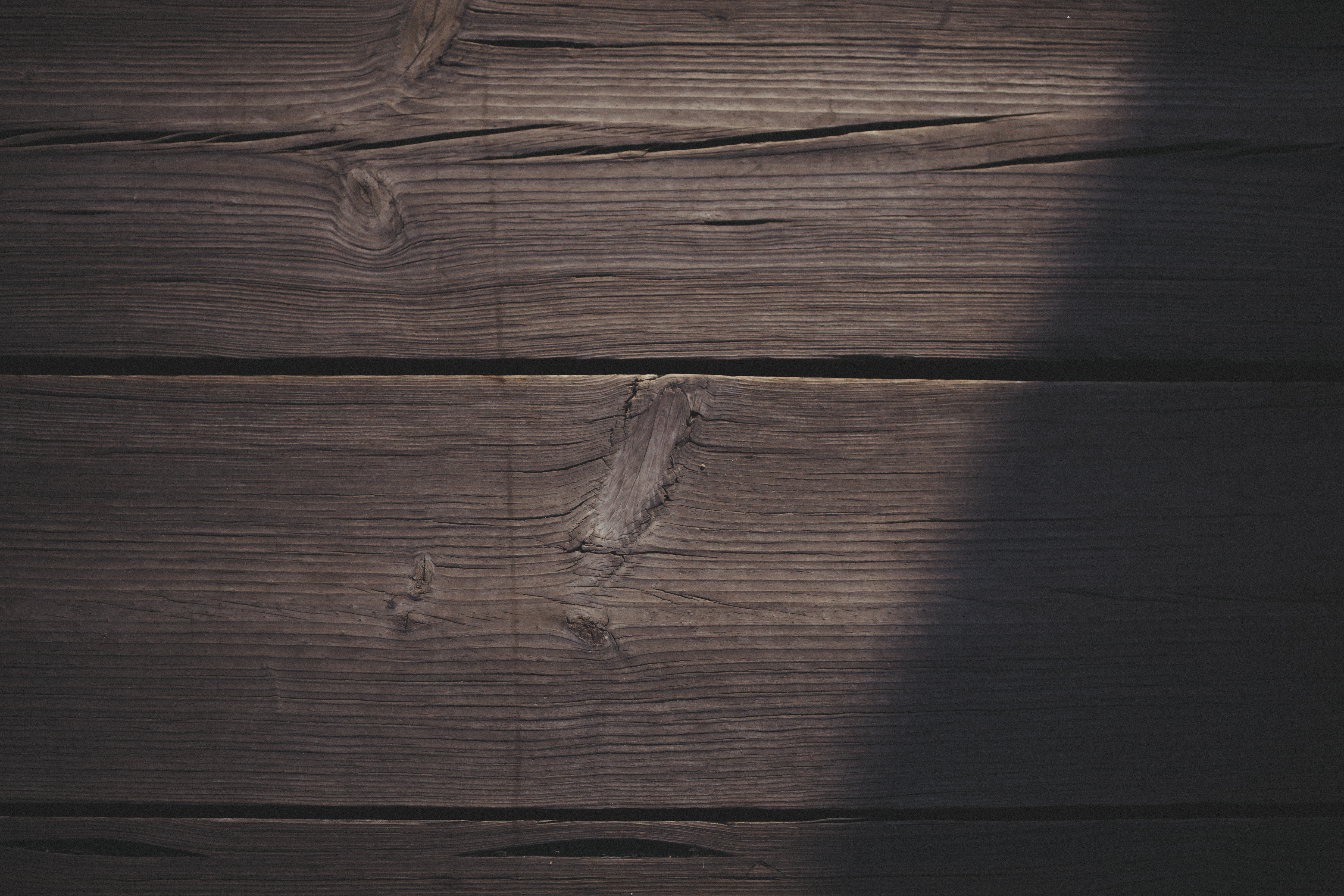 low light photography of brown planks