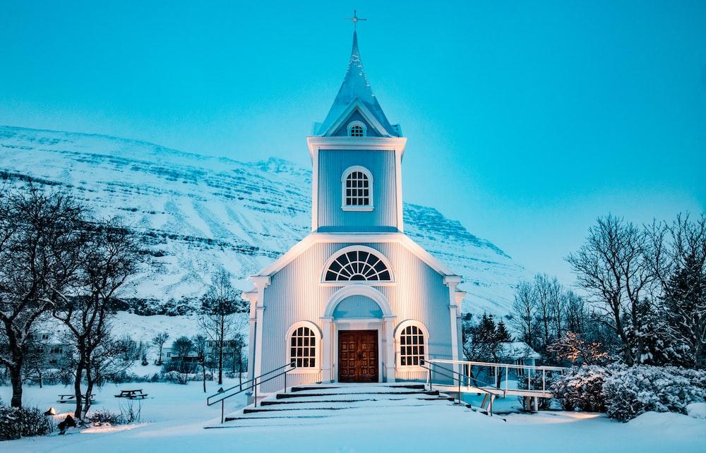 blue church during winter season