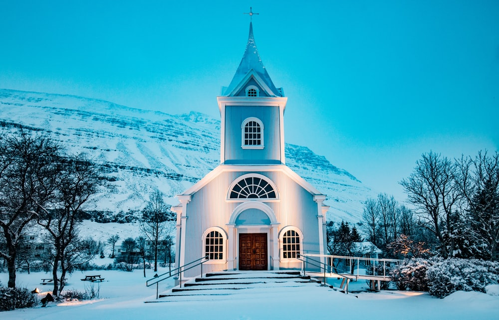 blue church during winter season