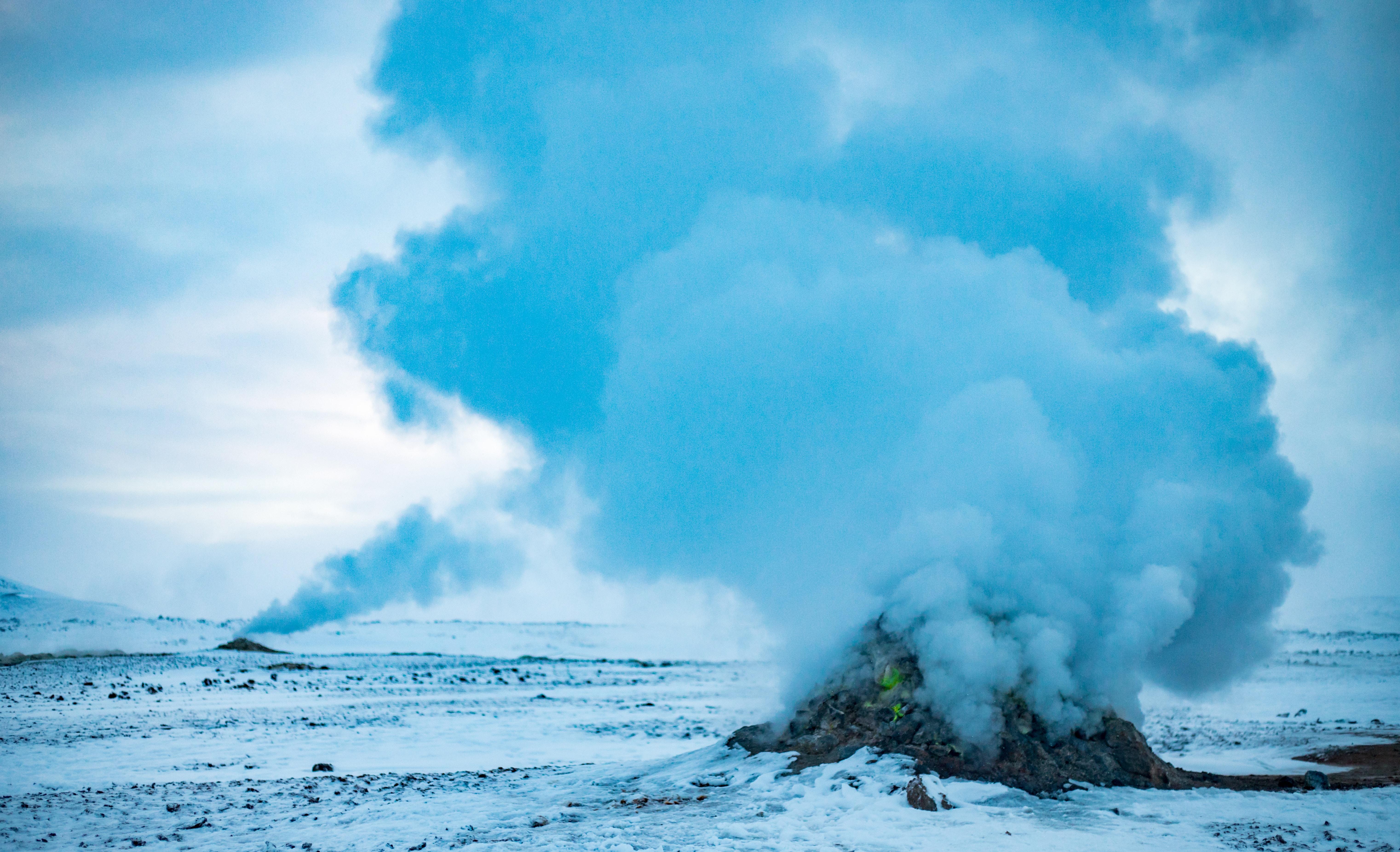 landscape photography of rock bursting smoke