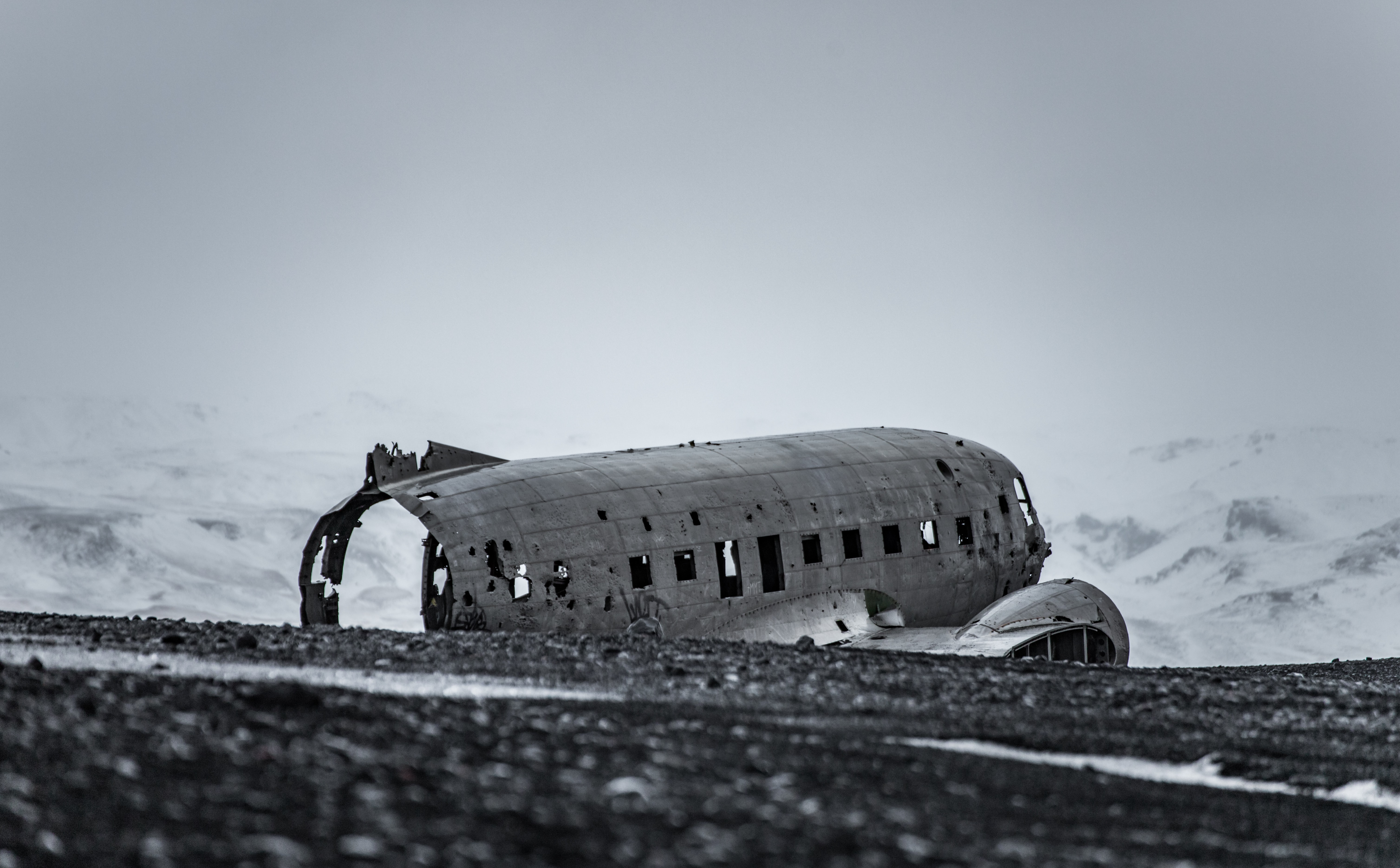 grayscale photography of wrecked airplane