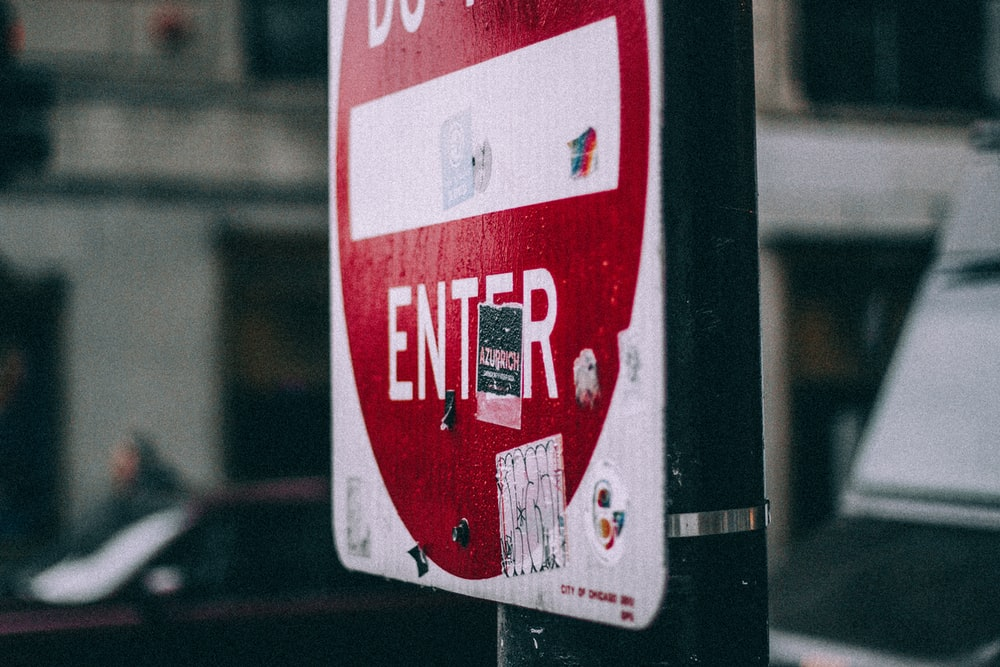 closeup photo of white and red do not enter signage