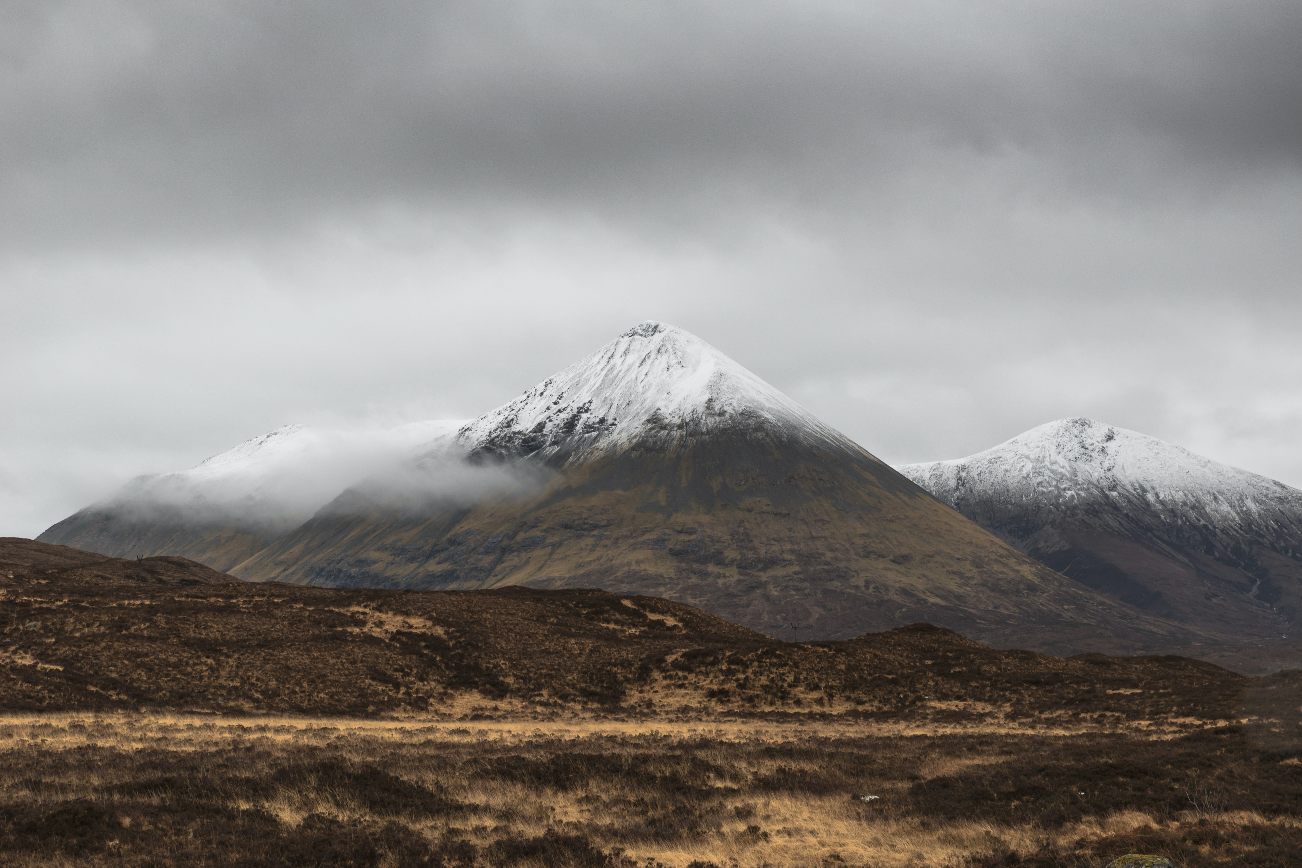 photo of brown and white mountain covered with snow