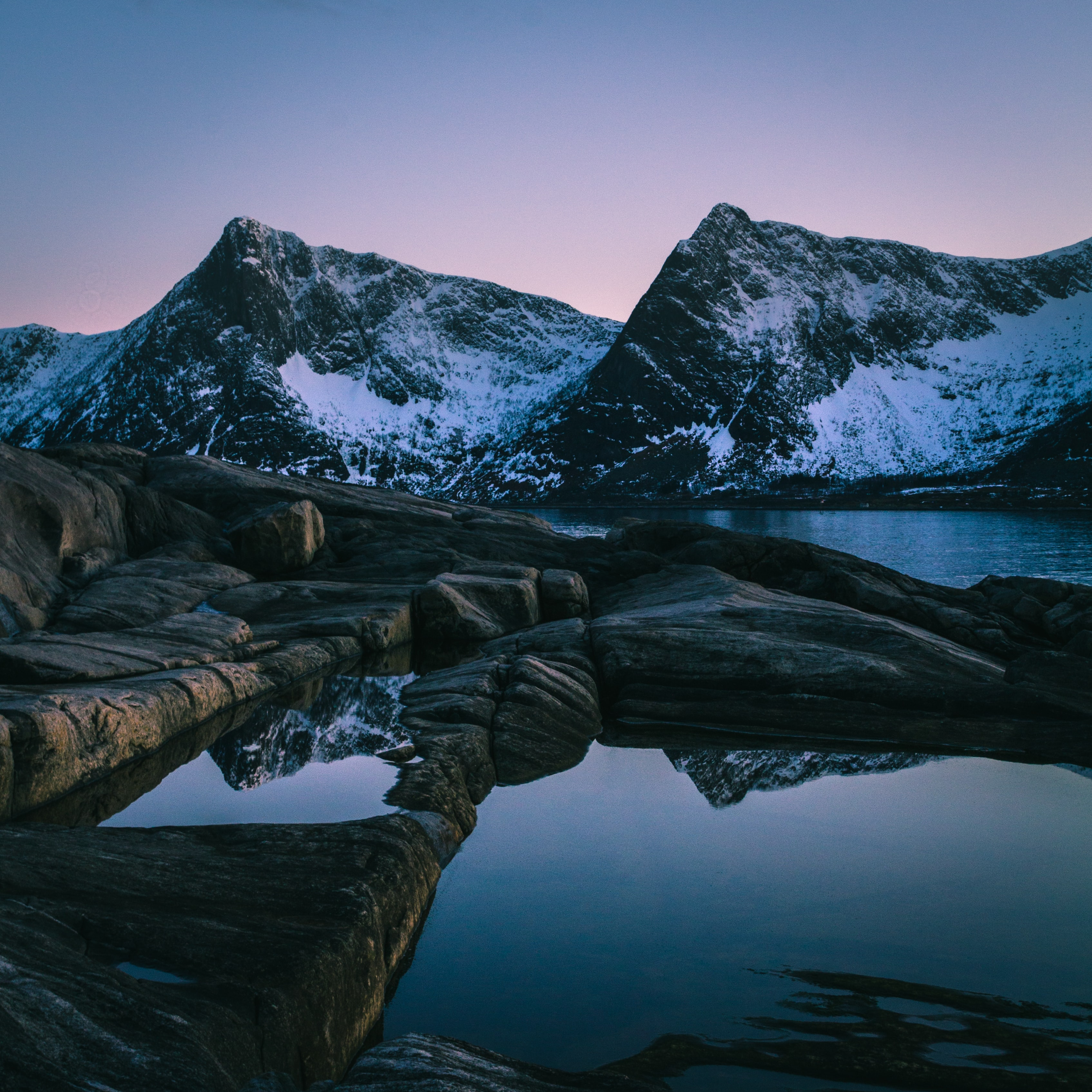 landscape photography of mountain beside body of water