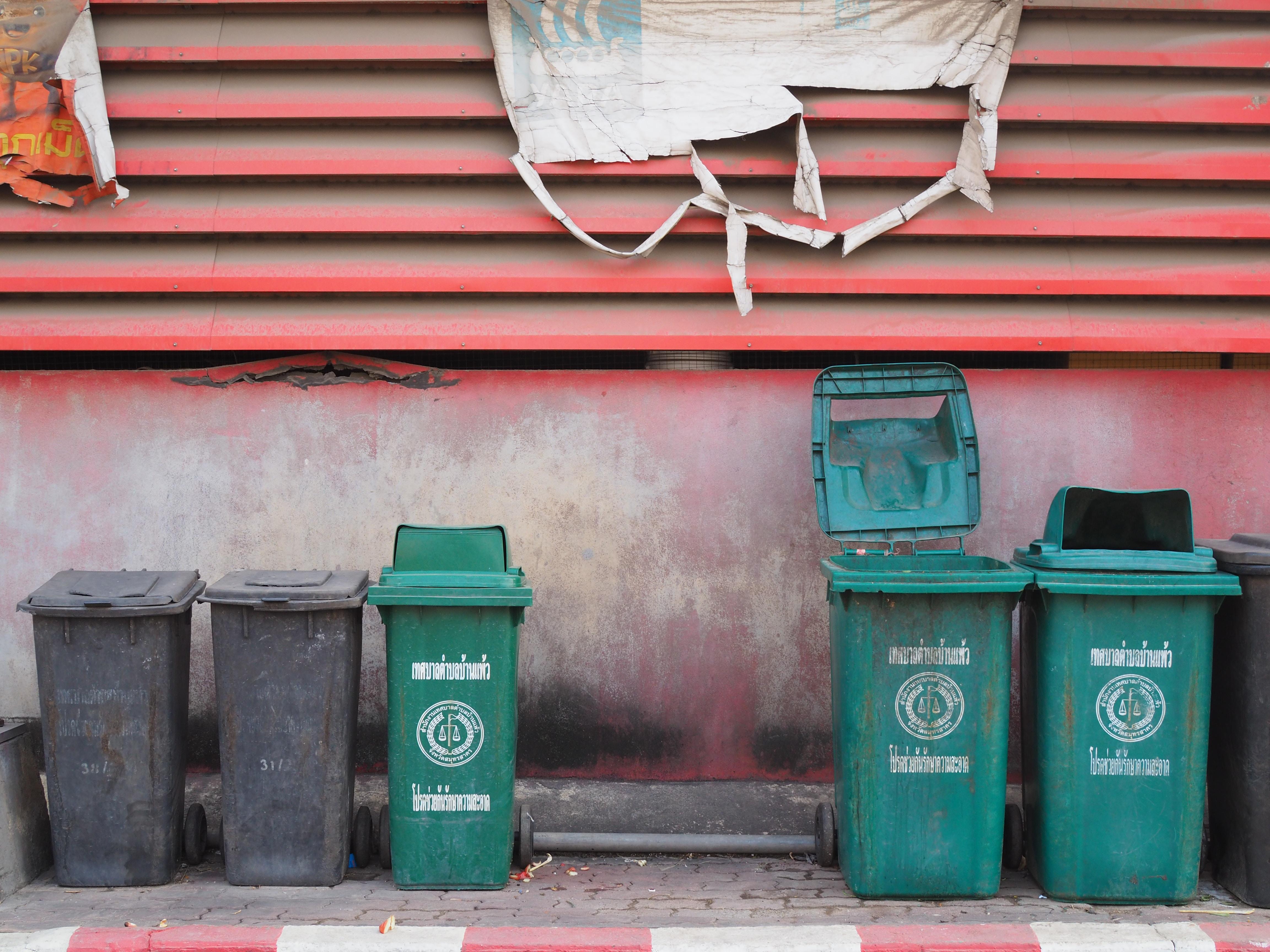 black and green trash bins