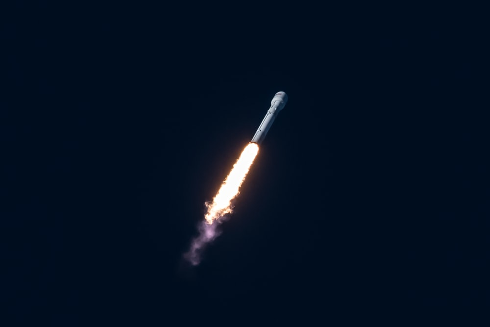 spacecraft flying through the sky