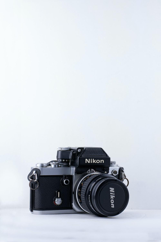 black Nikon camera against white background