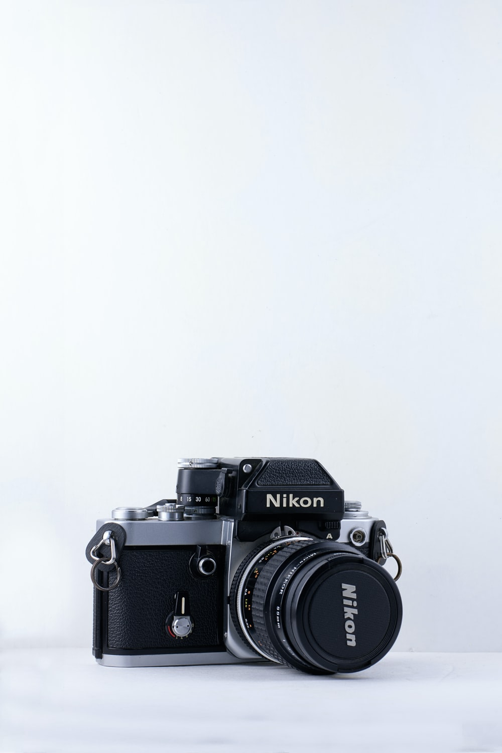 black Nikon camera against white background