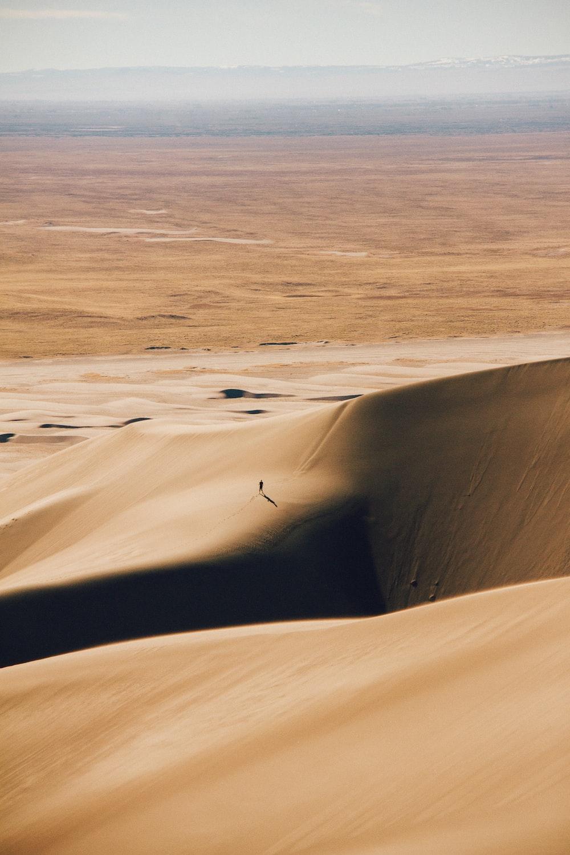 brown desert under white sky during daytime