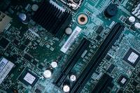 closeup photo of green computer motherboard