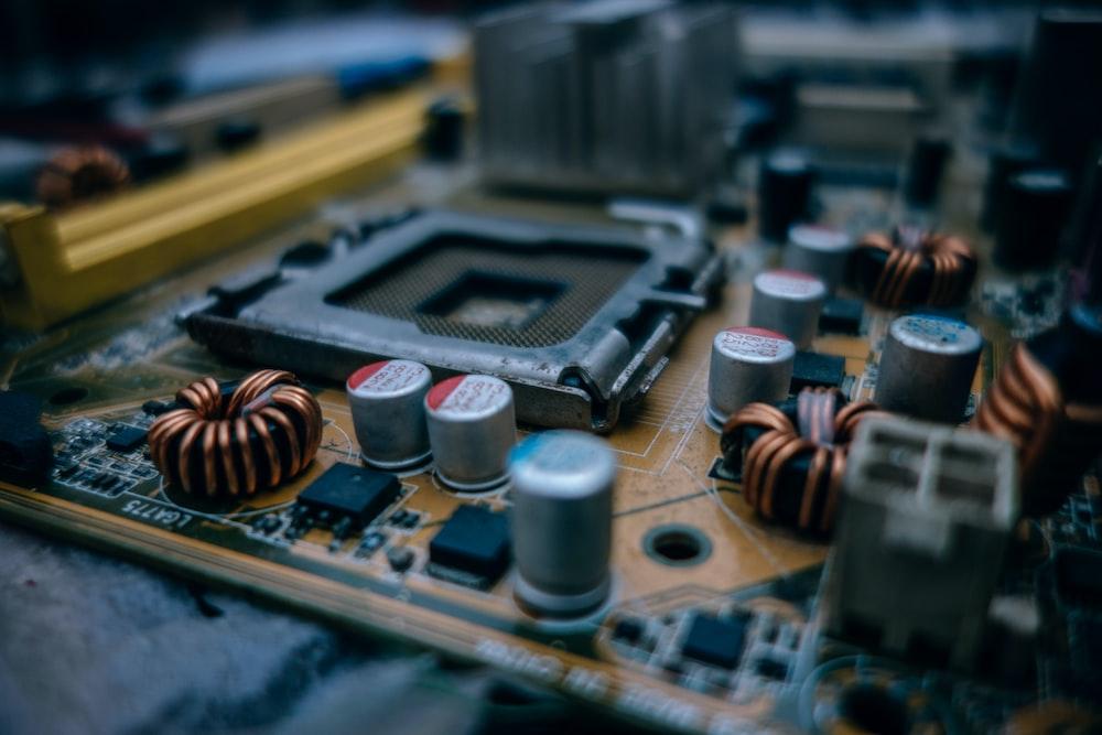 macro shot photography of brown motherboard